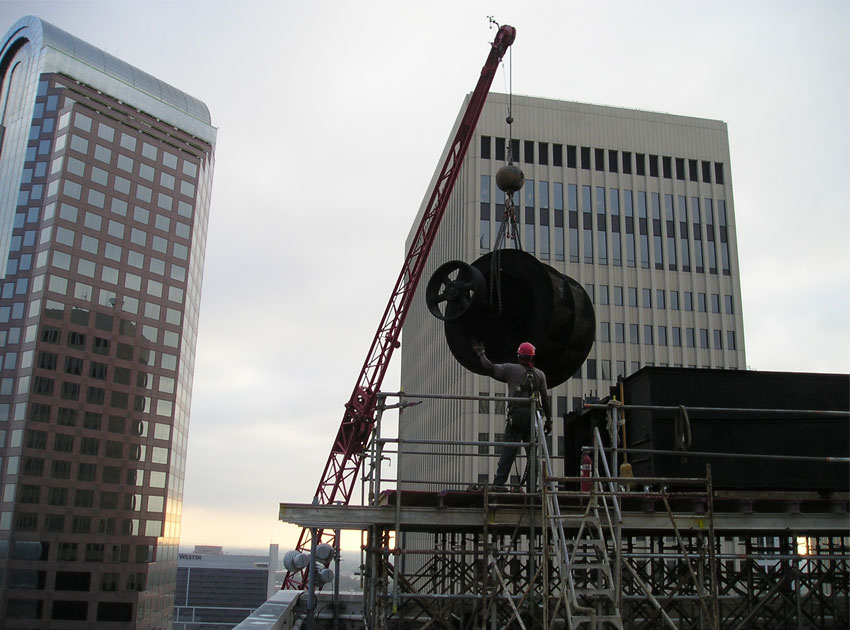 Our rigging team lifts a fan assembly atop a 240-foot tower.
